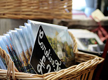 basket with local postcards